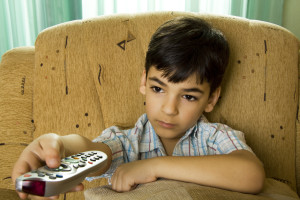 Young boy holding remote control pad